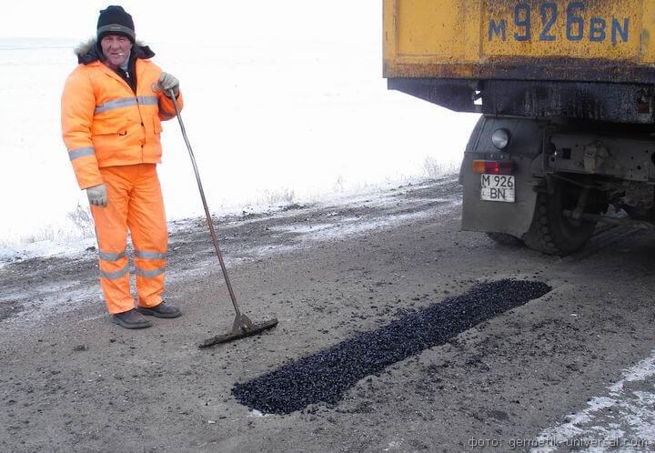 фото ремонт дороги зима